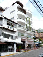 view of andales condo building AND on olas altas street