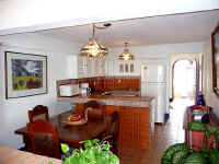 kitchen and dining area of this el Dorado condo
