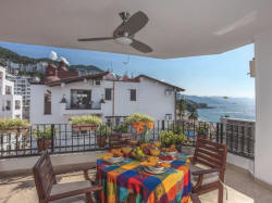 Enjoy the large patio with a view of the beach, Banderas Bay and the Romantic Zone