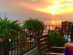 The La Palapa 606 balcony patio is the perfect place to enjoy the sunset - winter holidays