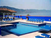 vds condo buildlng rooftop pool, terrace and view to south gay puerto vallarta