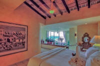 master bedroom with sitting area and views of Vallarta and Banderas Bay
