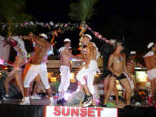 sunset cruise dancers - top gay vacation destination Puerto Vallarta