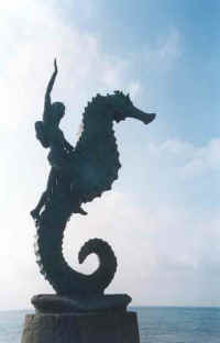 top gay resorts - seahorse statue downtown PV symbol by Rafael Zamarripa