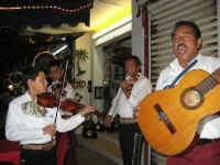 puerto vallarta street performers playing mariachi music