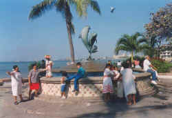 puerto vallarta tourism tourist information - Friendship fountain with dolphins by James Bottoms donated by Santa Barbara